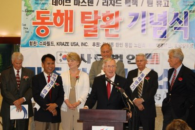 Photo of Delegate Plum speaking to a gathering of Korean Americans.