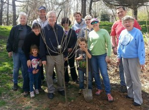 Photo of Delegate Ken Plum with Reston citizens planting a tree in his honor
