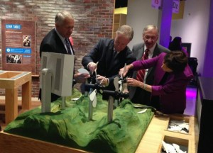 Photo of Delegate Plum and others doing wind experiments at Children's Science Center Lab
