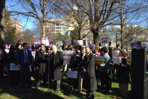 Photo of Delegate Plum speaking to advocates during their visit to Richmond about increasing the minimum wage.