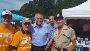 Photo of Delegate Plum,Governor McAuliffe, Lt. Governor Northam, and Stan Brock