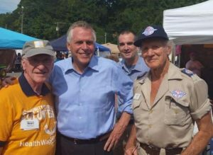 Photo of Delegate Ken Plum, Governor Terry McAuliffe, and Stan Brock